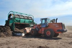 Digger moving compost