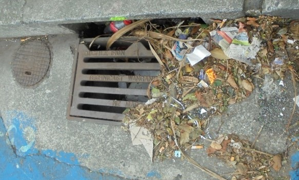 Storm drain filled iwth Rubbish